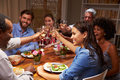 Friends At An Evening Dinner Party Royalty Free Stock Photo - 59872535