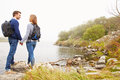 Young Couple Standing By A Lake, Looking At Each Other Royalty Free Stock Images - 59874229