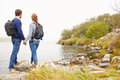 Young Couple Standing By A Lake Admiring The View Stock Images - 59875324