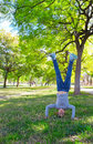 Kid Girl Handstands Upside Down In The Park Royalty Free Stock Images - 59901059