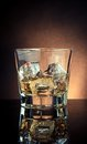 Glass Of Whiskey On Black Table With Reflection, Old Style Atmosphere Royalty Free Stock Images - 59904549