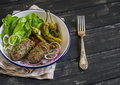 Lamb Kebab, Spicy Roasted Peppers And Fresh Green Salad On The  Plate On A Dark Wooden Surface Royalty Free Stock Photo - 59910535