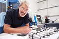 Engineer Planning Project With CNC Machinery In Background Stock Photography - 59928962
