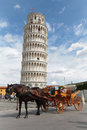 A Cab Waits In Front Of The Tower Of Pisa Stock Photos - 59937053