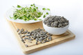 Green Young Sunflower Sprouts On Salad Plate And Sunflower Seeds Stock Photography - 59959772