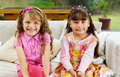 Brunette Children Sisters Sitting Happily On White Royalty Free Stock Photos - 59976198