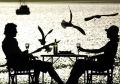 Couple Having A Meal By The Sea Royalty Free Stock Photography - 607557