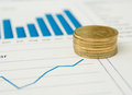 Gold Coins And Financial Reports Royalty Free Stock Photo - 60003785