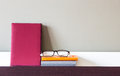 Book, Notebooks And Glasses On Shelf Stock Photography - 60005212
