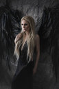 Beautiful Blond Woman In Black Dress With Black Wings Stock Images - 60019084