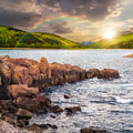 Mountain Lake With Rocky Shore At Sunset Royalty Free Stock Photo - 60020005