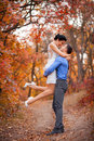 Smiling Couple Hugging In Autumn Park. Happy Bride And Groom In Forest, Outdoors Royalty Free Stock Image - 60046626