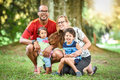 Happy Interracial Family Is Enjoying A Day In The Park Royalty Free Stock Photography - 60047847