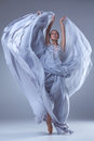 The Beautiful Ballerina Dancing In Blue Long Dress Royalty Free Stock Photography - 60052607