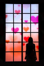 Women In Love Looking Through Big Window The Hearts In The Sky Royalty Free Stock Photos - 60072068