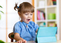 Child Playing With A Digital Tablet At Home Royalty Free Stock Photo - 60096885