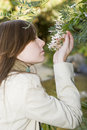 Girl Smelling Flowers Stock Photography - 6016902