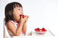 Asian Chinese Little Girl Eating Strawberries Royalty Free Stock Image - 60100676