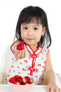 Asian Chinese Little Girl Eating Strawberries Royalty Free Stock Image - 60100876
