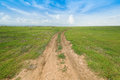 Soil Road Between Grass Field Royalty Free Stock Photos - 60101038