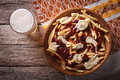Poutine And Beer Close-up. Horizontal Top View Stock Photography - 60120772