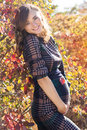 Young Pregnant Smiling Woman In The Autumn Park Stock Image - 60122601