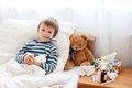 Sick Child Boy Lying In Bed With A Fever, Resting Stock Photos - 60140003