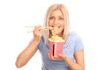 Beautiful Blond Woman Eating Chinese Noodles Stock Photo - 60140300