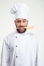 Male Chef Cook Holding Spoon In Teeth Royalty Free Stock Photography - 60148247
