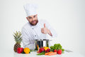 Male Chef Cook Preparing Food And Showing Thumb Up Royalty Free Stock Photo - 60149165