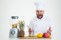 Chef Cook Sitting At The Table With Fruits Royalty Free Stock Photos - 60149728