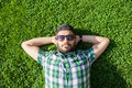 One Fashion Middle Eastern Man With Beard, Fashion Hair Style Is Resting On Beautiful Green Grass Day Time. Stock Image - 60162571