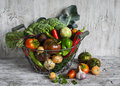 Fresh Garden Vegetables - Broccoli, Zucchini, Eggplant, Peppers, Beets, Tomatoes, Onions, Garlic - Vintage Metal Basket Royalty Free Stock Photos - 60167638