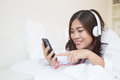 Young Happy Asian Woman Using Smartphone And Listen Music Stock Image - 60194251