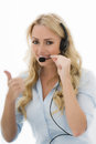 Attractive Happy Young Business Woman Using A Telephone Headset Stock Photos - 60222303