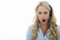 Attractive Young Business Woman Using A Telephone Headset Royalty Free Stock Images - 60224789