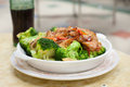 Stir-fried Pork And Broccoli Dish Served At A Hong Kong Cooked Food Centre Stock Photo - 60229530
