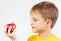 Little Boy In Yellow Shirt With Red Apple Royalty Free Stock Photos - 60270258