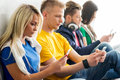 Group Of Students On A Break Reading Books And Using Smartphones Stock Photo - 60281440