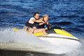 Couple Riding Jet Ski Royalty Free Stock Image - 60310496