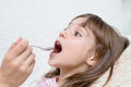 Little Girl  Taking Medicine With Spoon Stock Photo - 60328390