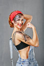 Girl Mechanic Shows Biceps. Royalty Free Stock Images - 60357119
