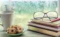 Eyeglasses On Book With Cookies  And Coffee Cup On Rainy Day Royalty Free Stock Image - 60360886