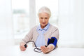 Old Woman With Tonometer Checking Blood Pressure Royalty Free Stock Photos - 60364608
