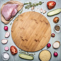 Raw Turkey Breast With Tomato And Pepper Radish Herbs And Cucumbers Over Wooden Cutting Board On Rustic Wooden Background Top View Stock Photo - 60369360