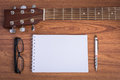 Guitar Notebook, Pencil And Eyeglasses Royalty Free Stock Photos - 60376528