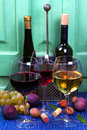 Red, Rose And White Glasses And Bottles Of Wine. Grape, Fig, Nuts And Leaves On Old Blue Table. Stock Images - 60378924
