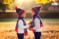 Adorable Little Brothers With Teddy Bear In Park On Autumn Day Royalty Free Stock Photography - 60386517