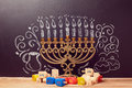 Creative Jewish Holiday Hanukkah Background With Menorah And Spinning Tops Over Chalkboard Stock Images - 60391474