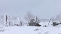The Old Rotten Fence In A Winter White Snowy Field Royalty Free Stock Images - 60393689
